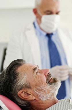 Dental Clayton Article Bearded Man in Dental Chair Smiling