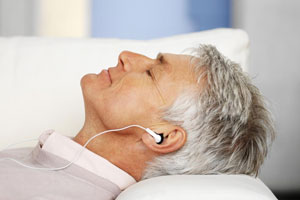 Dentistry Clayton Article Man Laying On Pillow WIth EarPhones